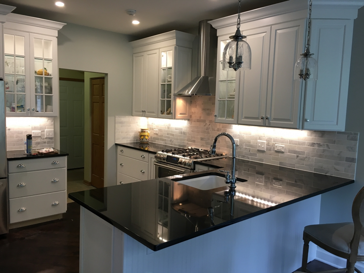 Kitchen remodel with custom cabinets, quartz counter top, subway style marble tile backsplash, and new vent hood